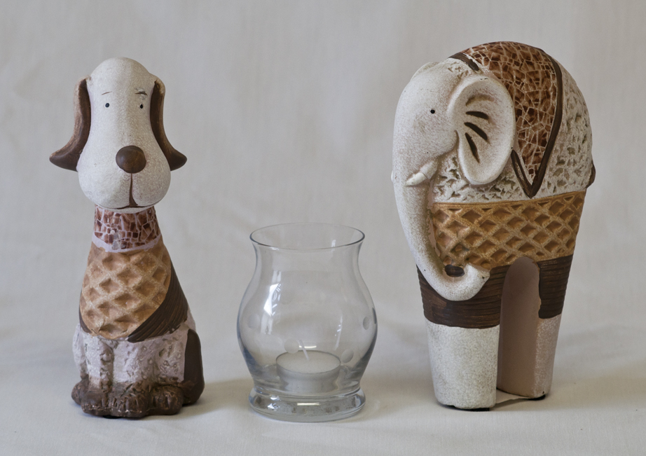 An image showing ceraminc dog and elephant.