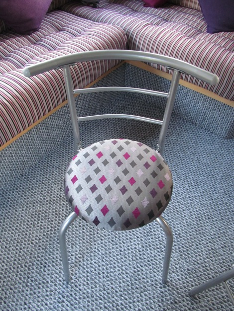 An image showing a small caravan dining chair, reupholstered, An image showing caravan upholstery, curtains, scatter cushions made by Advance Upholstery, Bispham, Blackpool